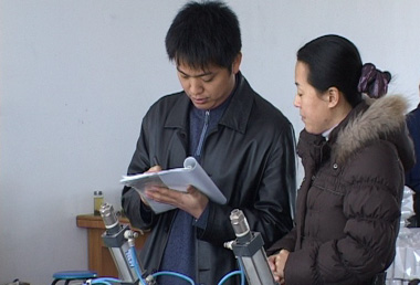 An SGS auditor (left) carefully collecting data.